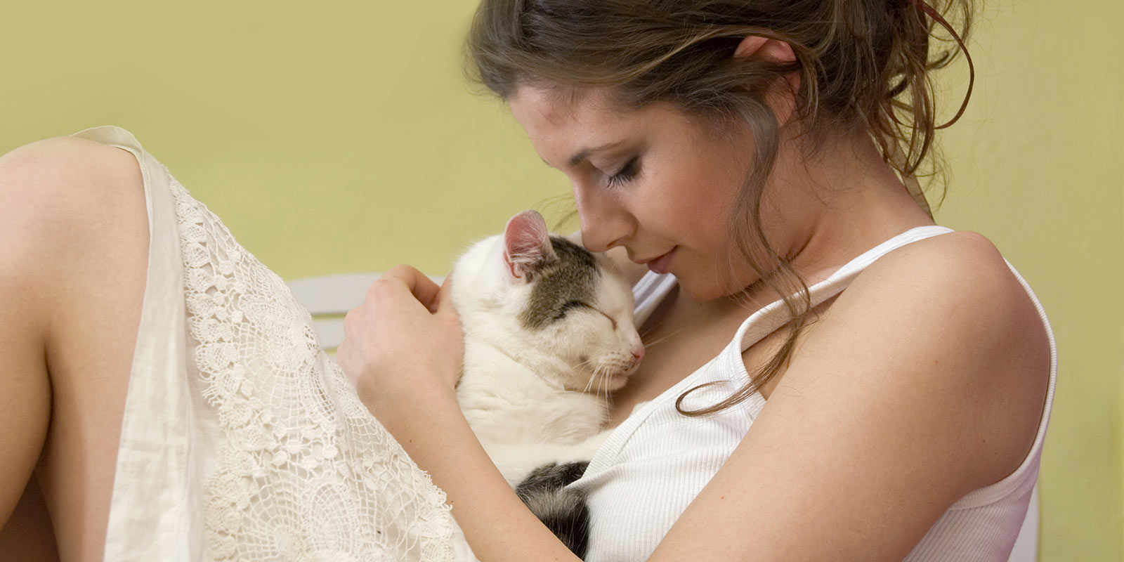 Woman cradling her cat.