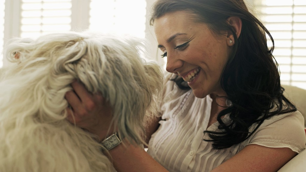 Woman with her shaggy dog.